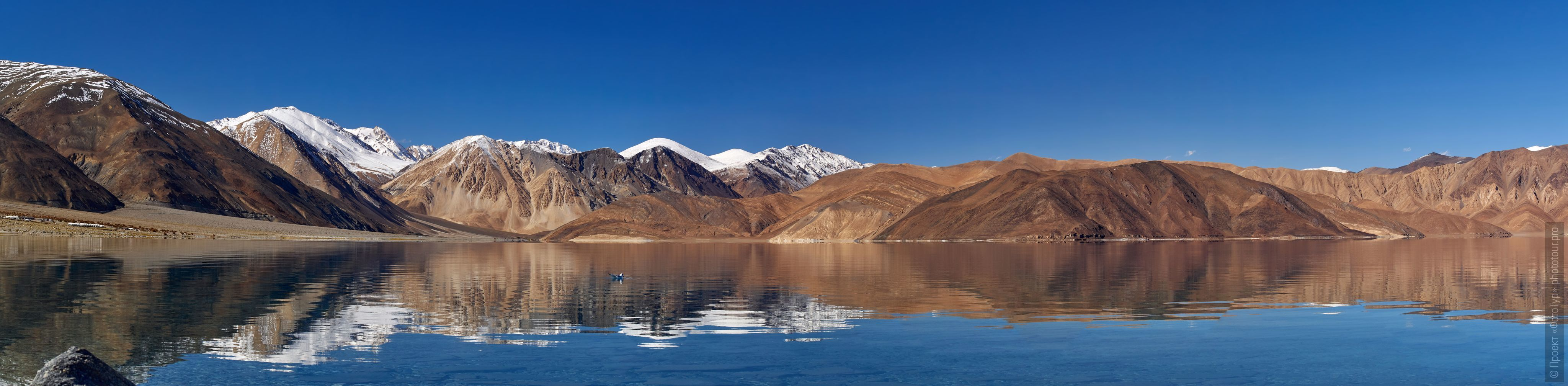 Pangong Tso Lake, Ladakh. Advertiser Tibet Lakes: Alpine lakes, geyser valley, Lamayuru, September 01 - 10.09. 2021.
