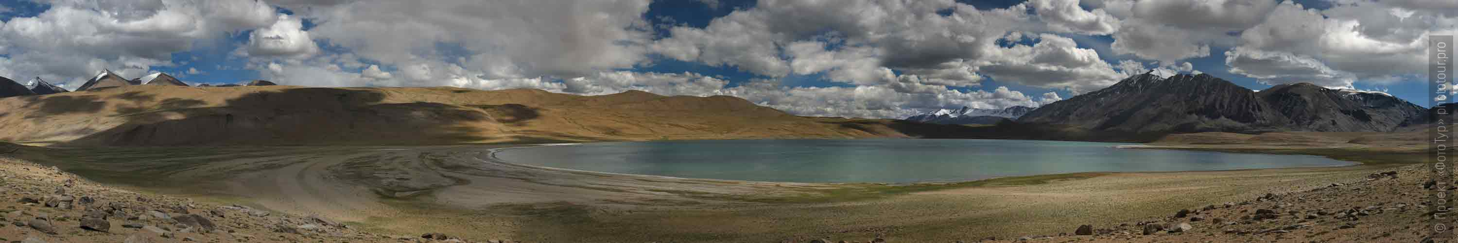 Kagyar Tso Lake. Tour Tibet Lakeside Advertising: Alpine lakes, geyser valley, Lamayuru, Colored Mountains, 01 - 10.09. 2021 year.
