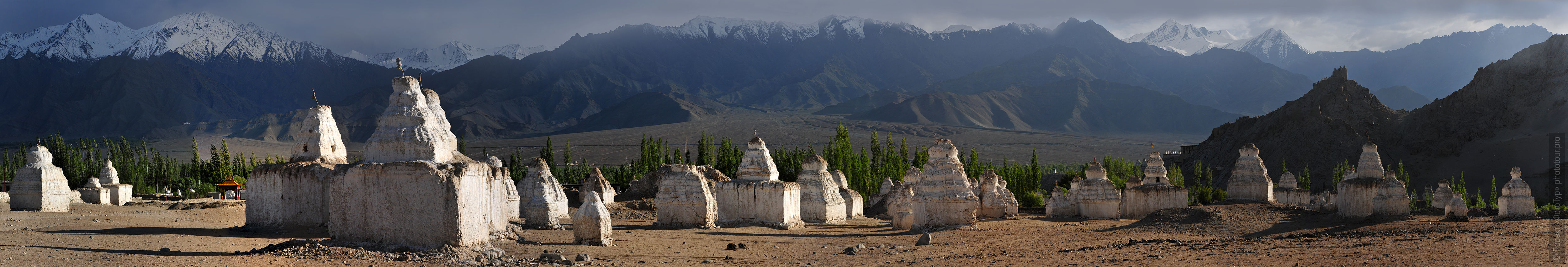 White stupas of Shay Gonpa. Tour Tibet Lakeside Advertising: Alpine lakes, geyser valley, Lamayuru, Colored Mountains, 01 - 10.09. 2021 year.